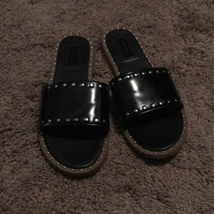 Black and studded sandals